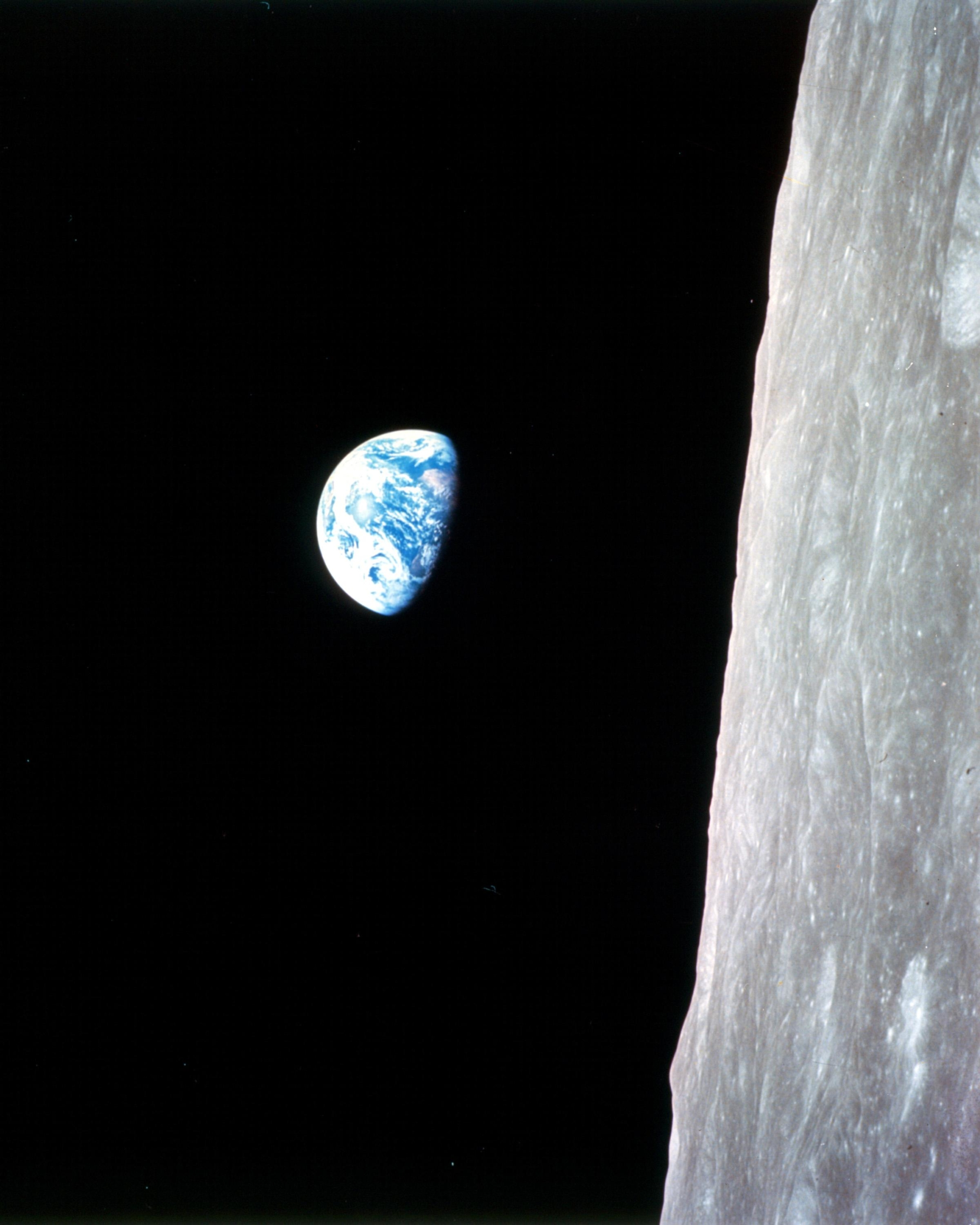 Photo of Earth within black galaxy from Apollo 8 near the moon
